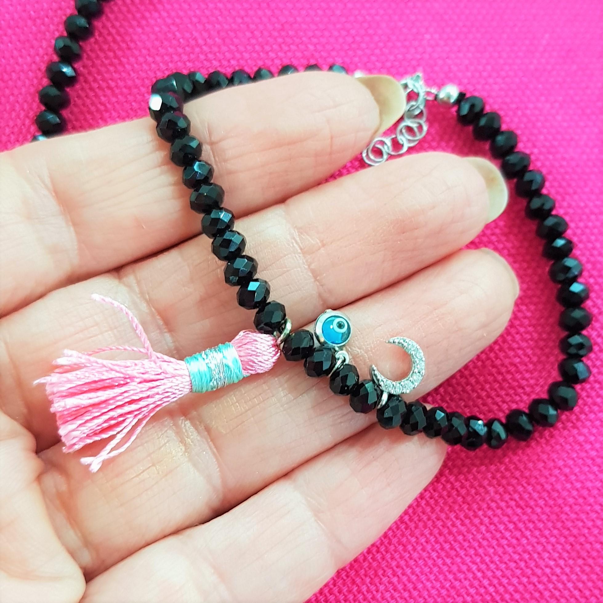 close up black bead charm bracelet