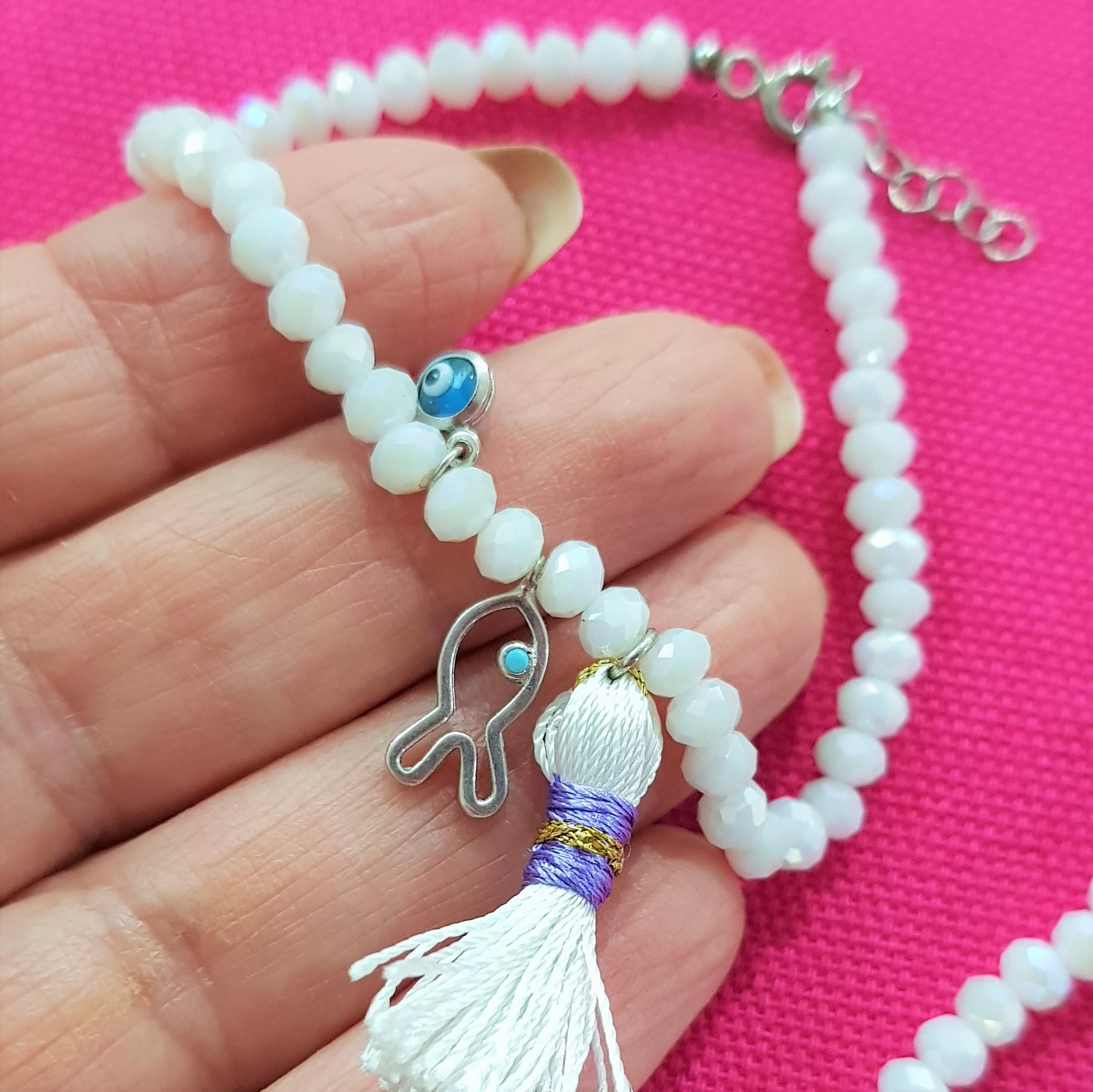 close up white bead bracelet